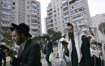 File: Jews pray on a street near the tomb of Rabbi Nachman of Bratslav in Uman, Ukraine, Sept. 20, 2006. (Menahem Kahana/AFP)