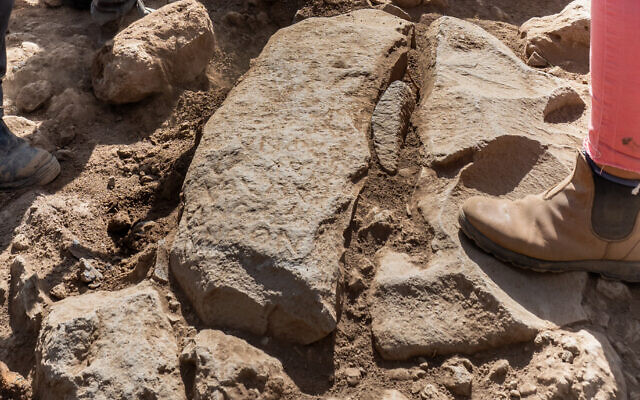 The inscription on the 3rd-century CE boundary stone at Israel Antiquities Authority excavations at Nafah in the Golan Heights (Assaf Peretz/Israel Antiquities Authority)