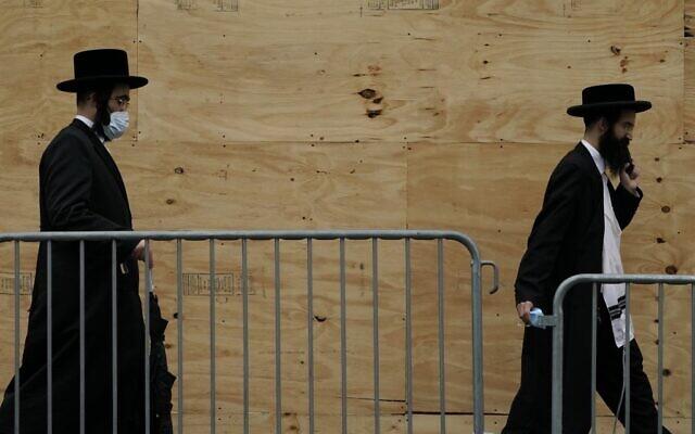 Illustrative: Orthodox Jewish men walk through a Brooklyn neighborhood on September 29, 2020 in New York. (Timothy A. Clary/AFP)