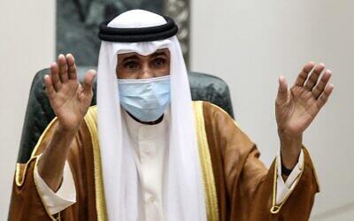 Sheikh Nawaf al-Ahmad Al-Sabah salutes the crowd after being sworn in as Kuwait's new emir, at the National Assembly in Kuwait City on September 30, 2020. (Yasser Al-Zayyat/AFP)