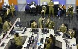 Members of the Israeli COVID-19 task force, part of the Israel Army Home Front Command, attend a meeting at the task force crisis headquarters in Ramla on September 30, 2020. (Emmanuel DUNAND / AFP)