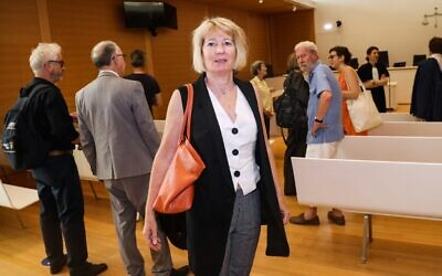 Claire Gimpel arrives in the Paris appeals court courtroom for the opening of a trial with members of her family, descendants of Jewish art collector Rene Gimpel, who filed suit against the state for restitution of three Andre Derain paintings looted during WWII in Paris; June 25, 2019. (Jacques DEMARTHON/AFP)