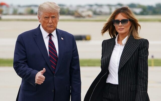 US President Donald Trump and First Lady Melania Trump step off Air Force One upon arrival at Cleveland Hopkins International Airport in Cleveland, Ohio on September 29, 2020 (MANDEL NGAN / AFP)