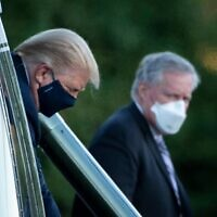 White House Chief of Staff Mark Meadows (R) watches as US President Donald Trump walks off Marine One while arriving at Walter Reed Medical Center in Bethesda, Maryland, on October 2, 2020. (Brendan Smialowski/AFP)