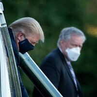 White House Chief of Staff Mark Meadows (R) watches as US President Donald Trump walks off Marine One while arriving at Walter Reed Medical Center in Bethesda, Maryland on October 2, 2020 (Brendan Smialowski / AFP)