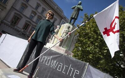 Lena Floerl, 25, a member of a prominent feminist organization, takes part in a so-called 'vigil of shame' in Vienna, Austria on October 6, 2020 (JOE KLAMAR / AFP)
