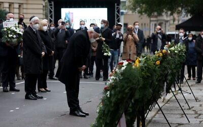 German President Frank-Walter Steinmeier (C) and President of the Central Council of Jews in Germany Josef Schuster (2nd-L) attend a commemoration service on the first anniversary of the anti-Semitic attack on the synagogue in Halle, Germany, on October 9, 2020. (Ronny Hartmann/AFP)