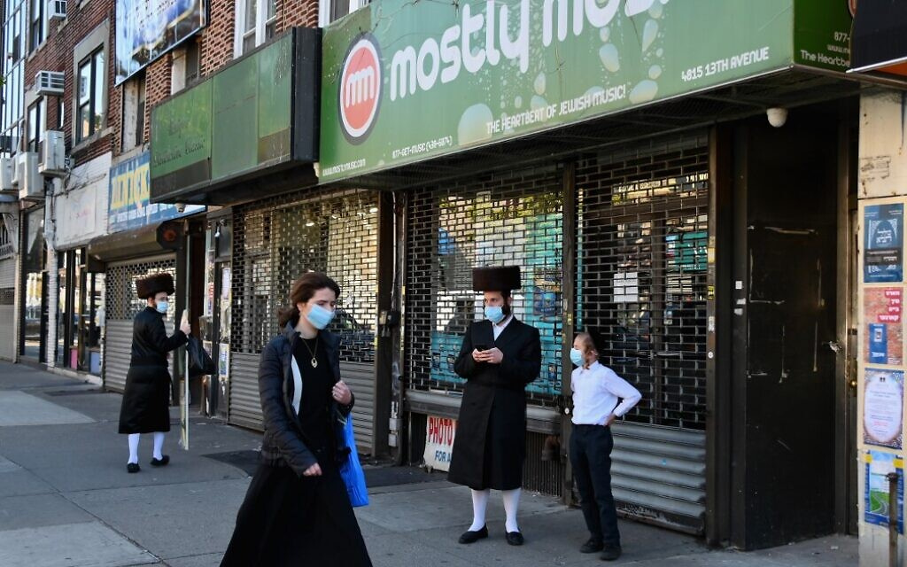 Illustrative: People walk past closed stores in the Borough Park section of Brooklyn, one of the five boroughs of New York City, on October 9, 2020. (Angela Weiss/AFP)