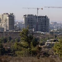 New apartments buildings under construction in the Beit El settlement in the West Bank with the Palestinian city of Ramallah in the background, October 13, 2020. (Menahem Kahana/AFP)