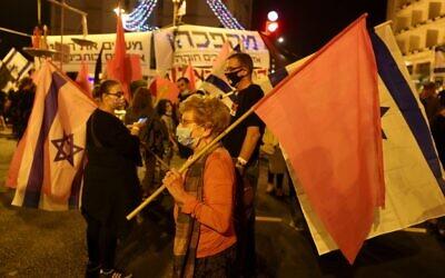Protesters gather for a demonstration against Prime Minister Benjamin Netanyahu near his residence in Jerusalem on October 17, 2020. (Menahem Kahana/AFP)