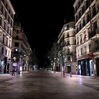 A deserted Republique street in Lyon, as a curfew is in place to fight the spread of COVID-19 (JEFF PACHOUD / AFP)