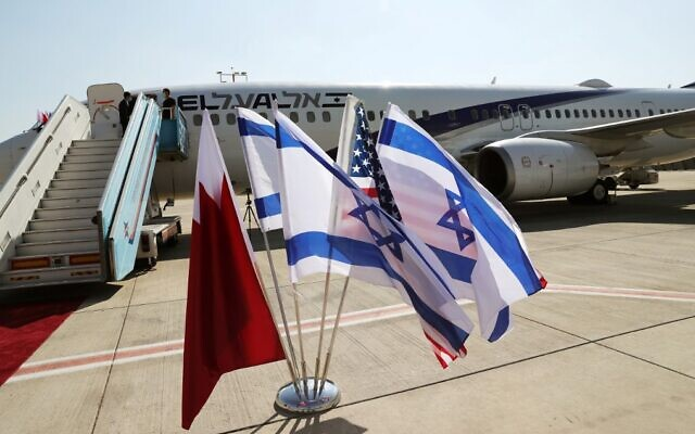 The Bahraini, Israeli and US flags are pictured in front of an El Al plane ahead of a flight to Bahrain's capital Manama from Ben Gurion Airport near Tel Aviv on October 18, 2020. (Ronen Zvulun/Pool/AFP)