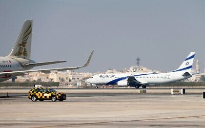 The El Al plane carrying a joint US-Israeli delegation lands at the Bahrain International Airport on October 18, 2020, to formalize the US-brokered normalization deal between Jerusalem and Manama. (Hamad Mohammed/Pool/AFP)