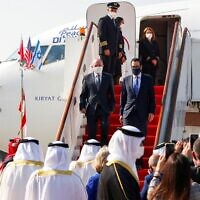 National Security Adviser Meir Ben-Shabbat (L) and US Treasury Secretary Steve Mnuchin disembark from a plane upon their arrival at the Bahraini International Airport on October 18, 2020. (Ronen Zvulun/Pool/AFP)