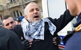 In this file photo taken on December 29, 2012, President of the Cheikh Yassine collective Abdelhakim Sefrioui (C) is checked while being arrested by French anti-riot gendarmes after an unauthorized pro-Palestinian protest in Paris  (Miguel MEDINA / AFP)