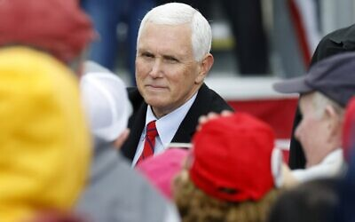 """US Vice President Mike Pence greets supporters after his """"Make America Great Again!"""" campaign event at Oakland County International Airport in Waterford, Michigan, on October 22, 2020. (JEFF KOWALSKY / AFP)"""