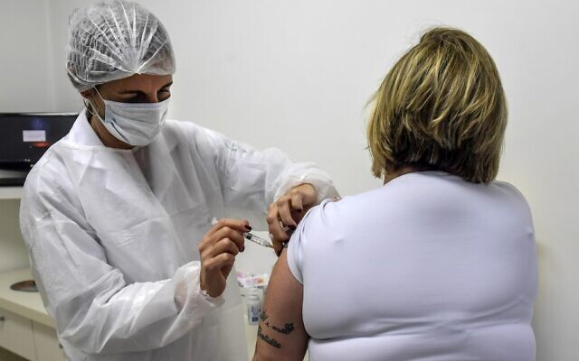 Brazilian pediatric doctor Monica Levi, one of the volunteers who received the COVID-19 vaccine, works at the Specialized Clinic in Infectious and Parasitic Diseases and Immunizations (CEDIPI), in Sao Paulo, Brazil, July 24, 2020. (NELSON ALMEIDA / AFP / File)