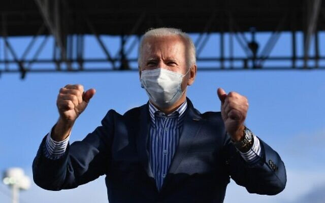 Then-Democratic presidential nominee Joe Biden waves to supporters before speaking at a drive-in rally at Dallas High School, in Dallas, Pennsylvania, on October 24, 2020. (Angela Weiss / AFP)