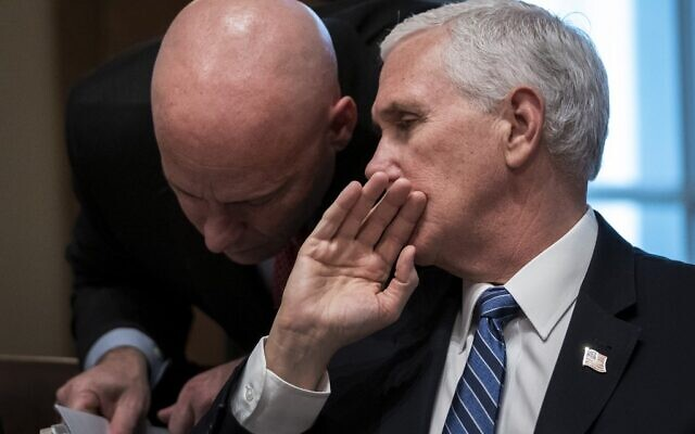 In this file photo taken on March 2, 2020 US Vice President Mike Pence and his chief of staff Mark Short confer during a meeting with the White House Coronavirus Task Force and pharmaceutical executives in Cabinet Room of the White House in Washington, DC. (Drew Angerer / GETTY IMAGES NORTH AMERICA / AFP)