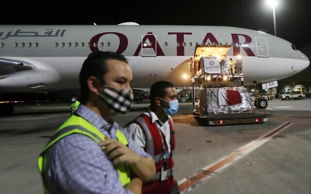 Supplies to tackle the coronavirus pandemic donated by the Qatar Fund for Development are loaded onto a Qatar Airways flight to Kigali in Rwanda at Doha's Hamad International Airport, April 28, 2020. (Photo by KARIM JAAFAR / AFP)