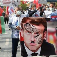 Men hold a sign bearing a picture of French President Emmanuel Macron with a Hitler mustache and a shoe print on it as Turkish protesters shout slogans during a demonstration against French President's comments over Prophet Muhammad cartoons, in Ankara, on October 27, 2020 (Adem ALTAN / AFP)