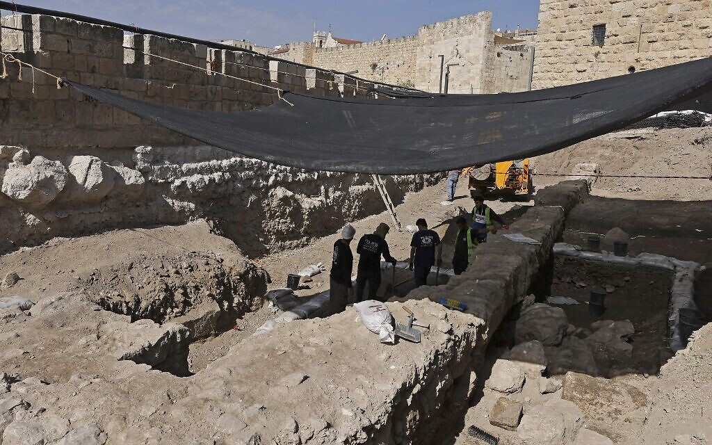 Workers dig at an archaeological site at the Tower of David Museum in the ancient citadel of Jerusalem near the Jaffa Gate entrance to Jerusalem's Old City on October 28, 2020. (MENAHEM KAHANA / AFP)