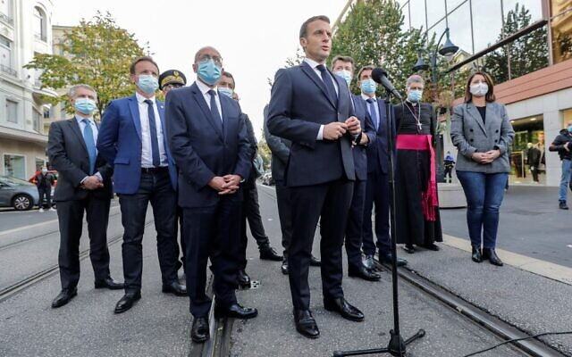 French President Emmanuel Macron (C) speaks to the press outside the the Notre-Dame de l'Assomption Basilica in Nice on October 29, 2020, after a knife-wielding man killed three people at the church in what officials are treating as the latest jihadist attack to rock France. (Eric Gaillard/Pool/AFP)