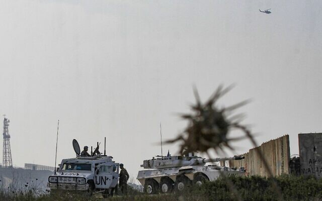 Soldiers form the Italian contingent with the UN Interim Force in Lebanon (UNIFIL) monitor the area near the southern Lebanese border town of Naqura during the second round of talks between Lebanon and Israel at a UN base on the demarcation of the maritime frontier between the two countries, on October 29, 2020. (Mahmoud ZAYYAT/AFP)