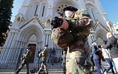 French soldiers secure the Notre-Dame de l'Assomption Basilica in Nice on October 30, 2020 during a tribute to the victims killed by a knife attacker the day before. (Valery Hache/AFP)