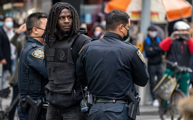 A person is arrested during a march and rally for President Donald Trump on 5th Avenue on October 25, 2020 in New York City. (David Dee Delgado/Getty Images/AFP)