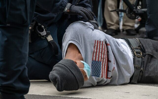 A person is arrested during a march and rally for President Donald Trump at Times Square on October 25, 2020 in New York City. (David Dee Delgado/Getty Images/AFP)