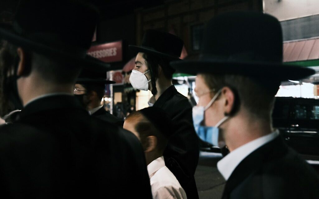 Illustrative: Young members of the Hasidic community gather in the Brooklyn neighborhood of Borough Park to denounce lockdowns of their neighborhood due to a spike in COVID-19 cases on October 7, 2020, in New York City. (Spencer Platt/Getty Images/AFP)