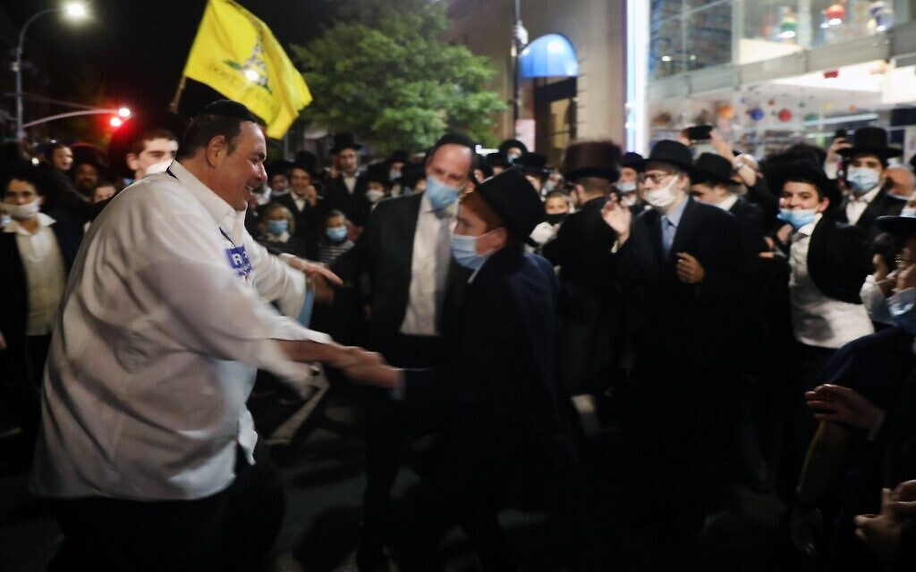 Heshy Tischler, left, leader of the Borough Park protests against Gov. Andrew Cuomo's new restrictions intended to stop the spread of the coronavirus, dances with Borough Park residents on October 7, 2020 in New York City. (Spencer Platt/Getty ImagesAFP )
