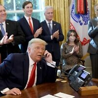 President Donald Trump speaks with Israeli Prime Minister Benjamin Netanyau on the phone about a Sudan-Israel peace agreement, in the Oval Office on October 23, 2020 in Washington, DC. President Trump announced that Sudan and Israel are making peace. (Win McNamee/Getty Images/AFP)