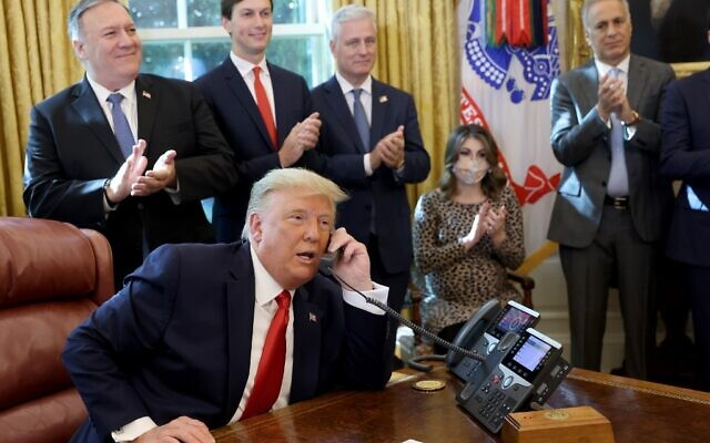 US President Donald Trump speaks with Prime Minister Benjamin Netanyahu on the phone about a Sudan-Israel peace agreement, in the Oval Office on October 23, 2020 in Washington, DC. (Win McNamee/Getty Images/AFP)