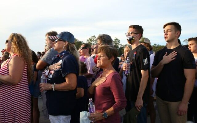 Supporters stand for the national anthem before a rally for US President Donald Trump on October 23, 2020 in Pensacola, Florida. (Jonathan Bachman/Getty Images/AFP)