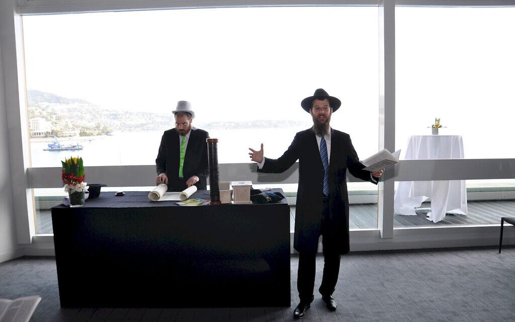 Rabbi Tanhoum Matusof reads from the Book of Esther on Purim in Monaco, February 28, 2018. (Courtesy of the Jewish Cultural Center of Monaco/ via JTA)