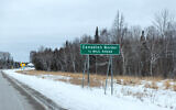 A sign marks the Canadian border. (Lorie Shaull/Flickr/ via JTA)