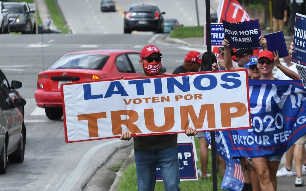 Illustrative: People hold placards after US Vice President Mike Pence addressed supporters at a Latinos for Trump campaign rally at Central Christian University in Orlando, Florida, on October 10, 2020. (Paul Hennessy/NurPhoto via Getty Images/ via JTA)