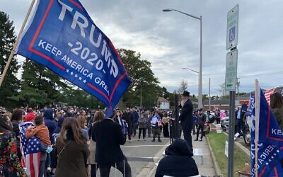 Rabbi Yitzchak Smith, a rabbi and lawyer who has has recently gained a following by promoting the idea there that COVID-19 testing is a government ploy to hurt Orthodox Jews, addressed a rally in support of Donald Trump and religious freedom in Long Island Sunday. (Shira Hanau/ JTA)