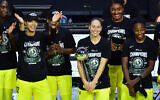 Sue Bird #10 of the Seattle Storm holds on to the WNBA Championship Trophy after defeating the Las Vegas Aces 92-59 in Game 3 of the WNBA Finals at Feld Entertainment Center on October 06, 2020, in Palmetto, Florida. (Julio Aguilar/Getty Images)