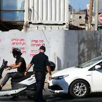 Illustrative: A police officer in Bnei Brak on October 18, 2020.  (Tomer Neuberg/Flash90)