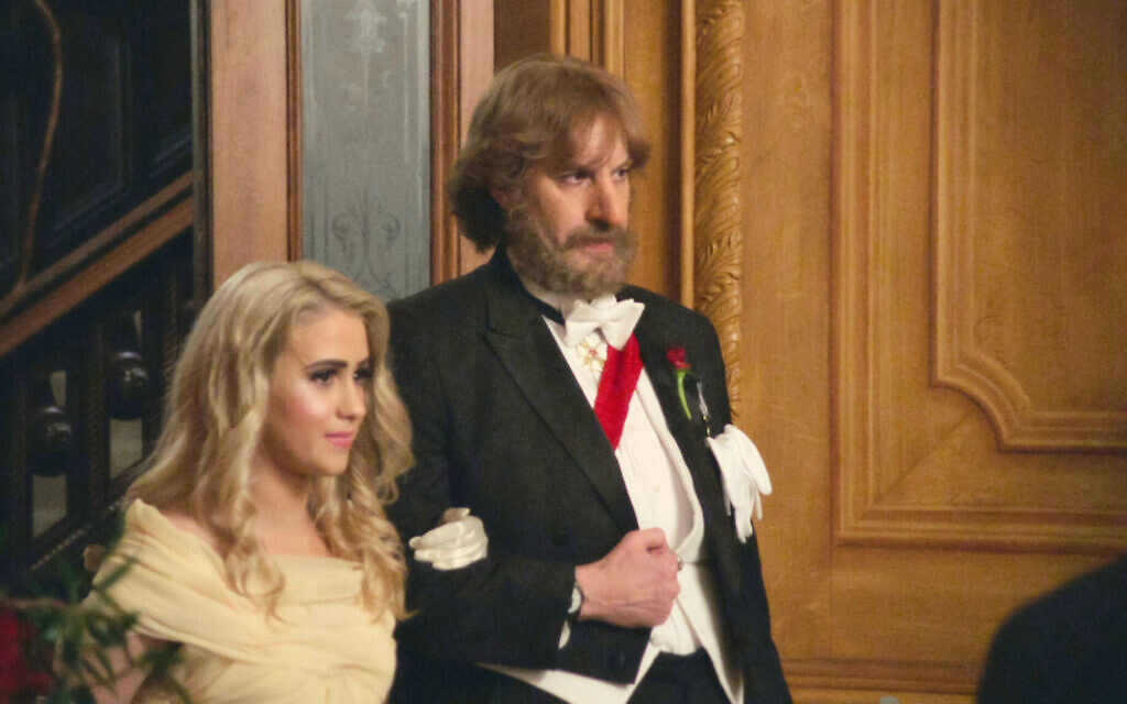 A still of Sacha Baron Cohen and actress Maria Bakalova, who plays his daughter, from 'Borat Subsequent Moviefilm: Delivery of Prodigious Bribe to American Regime for Make Benefit Once Glorious Nation of Kazakhstan.' (Courtesy Amazon)