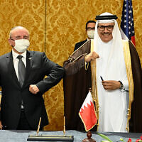 Bahraini Foreign Minister Abdullatif bin Rashid al-Zayani amd Israeli National Security Advisor Meir Ben Shabbat, at the signing ceremony of a peace agreement between Israel and Bahrain, in Manama, October 18, 2020. (Matty Stern/US Embassy Jerusalem)