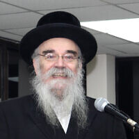 In this December 20, 2017, photo provided by Joel Friedman, Rabbi Avrohom Pinter makes a speech at Canvey Island,in Essex, southeast England. (Joel Friedman via AP)