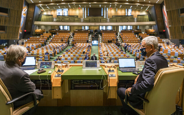United Nations Secretary General António Guterres, left, speaks with Volkan Bozkir, president of the seventy-fifth session of the United Nations General Assembly, ahead of the General Assembly's seventy-fifth session, September 22, 2020, at UN headquarters in New York. (Rick Bajornas/UN via AP)