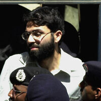 Ahmed Omar Saeed Sheikh, the alleged mastermind behind the Wall Street Journal reporter Daniel Pearl's kidnap-slaying, appears at the court in Karachi, Pakistan, March 29, 2002. (Zia Mazhar/AP)