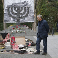People look at an art installation to mark the 79th anniversary of the 1941 Babi Yar massacre at a menorah monument close to the Babi Yar ravine where tens of thousands of Jews were killed during WWII, in Kyiv, Ukraine, September 29, 2020. (AP Photo/Efrem Lukatsky)