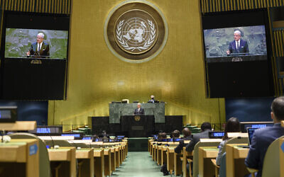 In this UN Photo, Volkan Bozkir, President of the 75th session of the United Nations General Assembly, is shown on video monitors as he makes closing remarks, September 29, 2020, at UN headquarters. (Loey Felipe/UN Photo via AP)