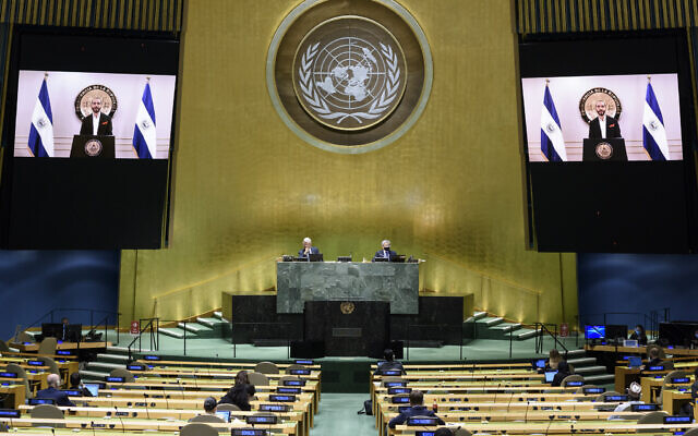 Nayib Armando Bukele, president of El Salvador, is shown on video monitors as he speaks in a pre-recorded video message, during the 75th session of the United Nations General Assembly, September 29, 2020, at UN headquarters. (Loey Felipe/UN Photo via AP)